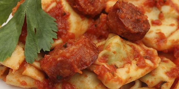 Pasta stuffed with chorizo and homemade tomato sauce
